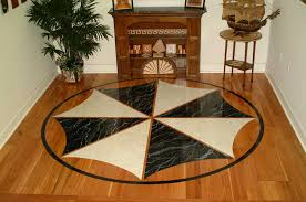 10ft painted scollopeddesign medallion in marble and sand stone tx austin flooring contractors for installation