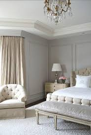 beige and gray bedroom with gray wall moldings