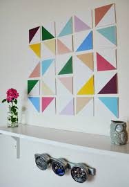 here is another fun and simple geometric wall art idea this literally takes no art skills whatsoever and even has a little dimension which i love as well  on diy dimensional wall art with diy dimensional geometric wall art a joyful riot
