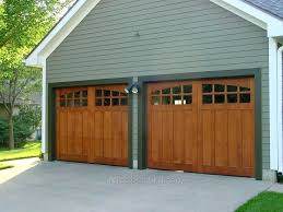 wooden door cost wood garage door cost cabinet solid of vs wrought iron ultra on dark garage doors
