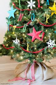 this christmas tree is just perfect for a kidu0027s room the hanging ornaments will make the kids excited so colorful stars and bead garland beads on christmas3
