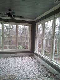 sun room reclaimed 100 yr old brick laid in a herringbone pattern antiqued