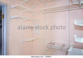 empty walk in closet. Empty Walk-in Closet With Shelves. Dressing Room Interior Elements. - Stock Image Walk In