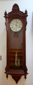item id 2071 seth thomas regulator no 19 ca 1885 the clock has the features of the very early seth 19 s the walnut case has the tulip pattern