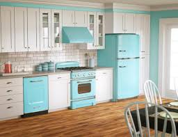 two toned full kitchen wall cabinet with white and teal colors and subway ceramic tile