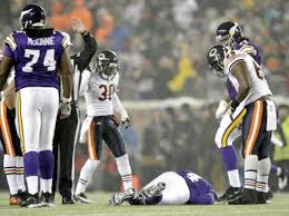 bears ko favre be for good ny daily news vikings qb brett favre lies on the ground after being tossed to the turf monday night