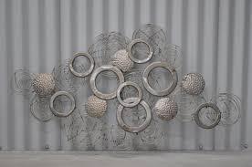 cole and gray metal wall art
