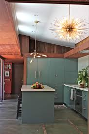 flat panel cabinets for midcentury kitchen with recessed lights
