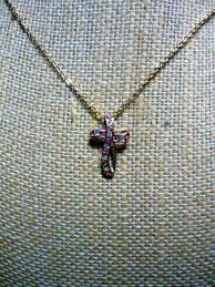 pink and clear rhinestone cross necklace marked c95