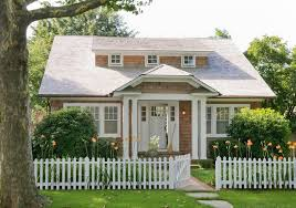 cottage exterior design exterior traditional with white pillar wood shingle siding white picket fence