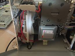 microwave teardown ifixit image 1 3 move the loose plastic harness which is holding the red