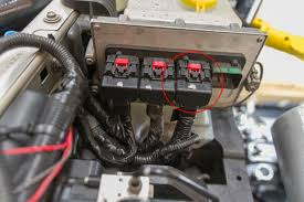 how to diy kill switch for jk wrangler expedition portal on the right when looking towards the front of the jeep unplug it and pull back the covering on the wires to the yellow wire orange stripe