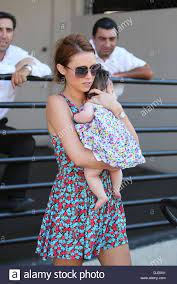 Una Healy and daughter Aoife Belle Foden get into a taxi to take them Stock  Photo - Alamy