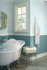 wall paint bathroom blue light pastel tones freestanding bathtub