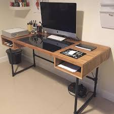 wood desk with steel pipe legs and an embedded plexiglass for the ideal drawing space