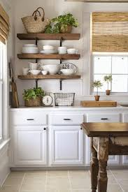 i love the contrast of the wooden shelves with dark metal finishes against the white shiplap in this stunning farmhouse kitchen makeover via aka design