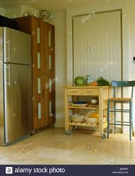 Limestone Flooring Kitchen Trolley In Front Of Vertical Radiator In Kitchen With Large