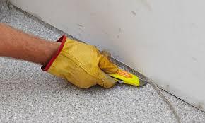 man cutting the vinyl floor