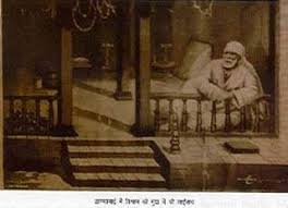 Image result for images of sai baba baba chilam with devotees