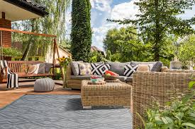 aztec outdoor mat in subtle shades fo grey white and beige