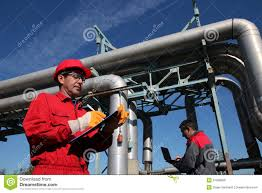 Two Industrial Engineers Working In A Factory Stock Image Image