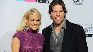 carrie underwood admits to applying makeup on her husband