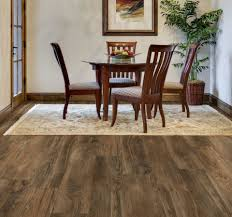 walnut allure vinyl plank flooring matched with white wall plus wooden baseboard molding and carpet plus dining table set for dining room decor ideas