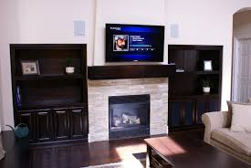 dark wood fireplace mantel in green valley ranch