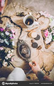 hand holding antique mirror. Close-up Of Human Hand With Tattoo Holding Beautiful Vintage Mirror Near Spring Flowers \u2014 Photo By KristinaPonomareva Antique L