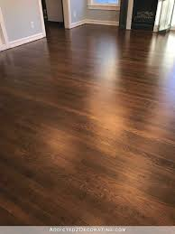 refinished red oak hardwood floors entryway and living room