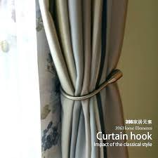 where to install curtain holdbacks how to install curtain curtain hooks home hardware curtain tieback wall