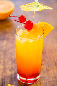 tequila sunrise l with orange cherries and an umbrella