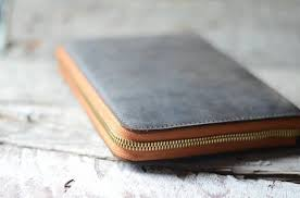 the second of a notebook cover i kinda like making those this one has a quite diffe closure mechanism rather than having a strap it has two