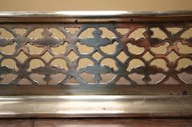 low regency antique brass fireplace fender