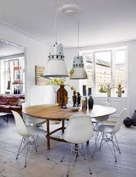 white eames chairs and round dining table