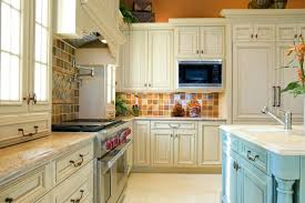 ceramic tile kitchen backsplash a country kitchen with a light blue island and multicolored ceramic tiles for the white subway tile kitchen backsplash