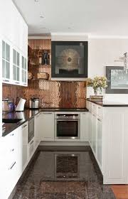 tiny copper tiles marble floors and white cabinets