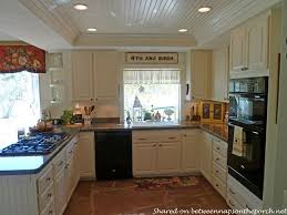 kitchen renovation with white cabinets granite recessed lighting 04