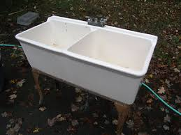 vintage porcelain farm sink or utility sink metal base w legs