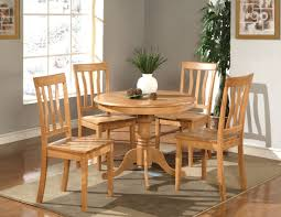 kitchen round table with 4 wood seat chairs in oak finish 36
