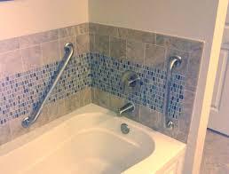 grab bars installed around bath tub bathroom grab bars