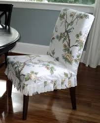 via living in the rain garden love this ikea yes ikea dining room chair slipcovers