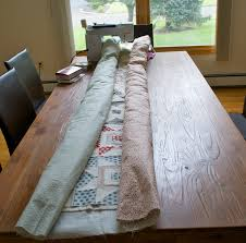 Let's begin sewing...: Quilting Large Quilts & Then I tried Leah Day's advise - DON'T roll your quilt up into a log to get  it under the arm of your machine! If you do this, the whole weight of that  ... Adamdwight.com