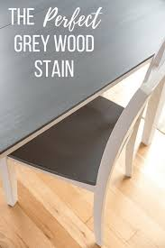 grey and white table and chair with text overlay the perfect grey wood stain