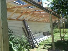 the 2x4 roof joists were attached at 2 ft intervals with nails an metal l brackets at the wall side and hurricane ties and nails on post side
