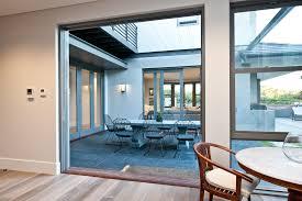 ... Opened timber cavity sliding door by Cedar West
