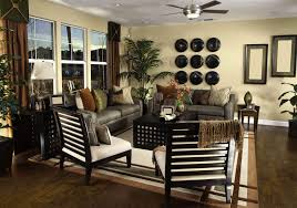 elegant living room with 2 sofas and 2 chairs in earth tones