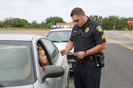 see what a day in the life as a cop is like police officer examining license of teenage girl
