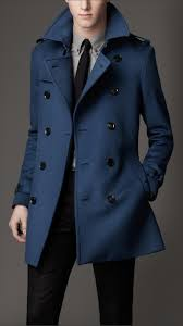 sport a classically cool look with men s trench coats from banana republic add an air