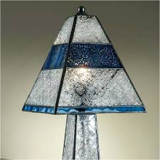 colored glass lamp shades the j pale blue stained glass table lamp has a tapered rectangular shape it is four sided with textured frosted and clear glass